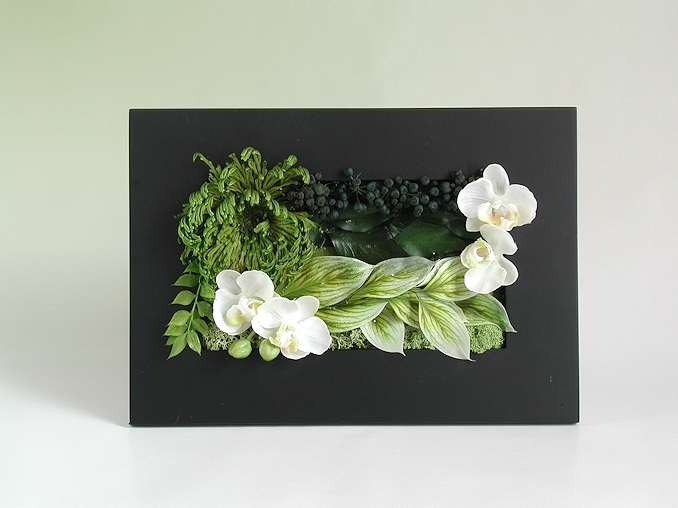 Nature in Frame Dried leaves and artificial flowers in a frame